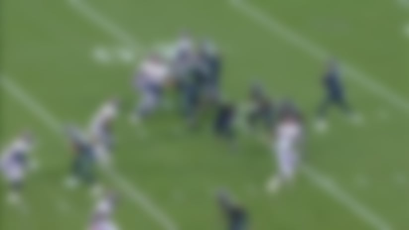 Dekoda Watson gets after Geno Smith for a loss of 12 yards