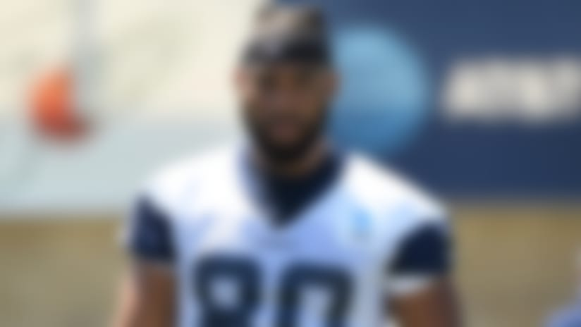Dallas Cowboys tight end Rico Gathers (80) huddles with his teammates at the NFL football team's training camp in Oxnard, Calif., Saturday, July 27, 2019. (AP Photo/Michael Owen Baker)