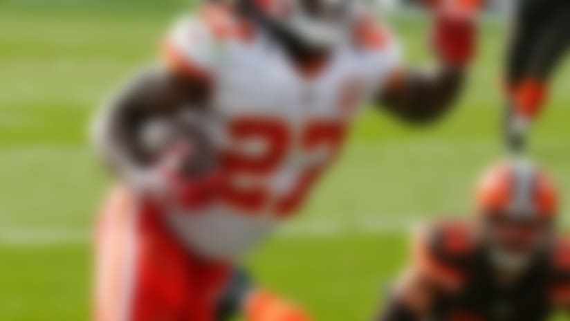 Kansas City Chiefs running back Kareem Hunt, left, runs for a 10-yard touchdown during the second half of an NFL football game against the Cleveland Browns, Sunday, Nov. 4, 2018, in Cleveland. (AP Photo/Ron Schwane)