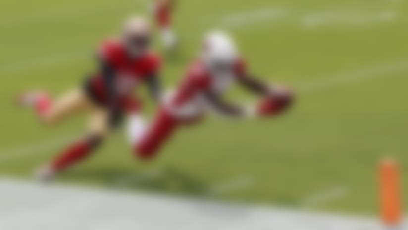 Arizona Cardinals running back Chase Edmonds (29) dives past San Francisco 49ers middle linebacker Kwon Alexander (56) to score a touchdown during the first half of an NFL football game in Santa Clara, Calif., Sunday, Sept. 13, 2020. (AP Photo/Josie Lepe)