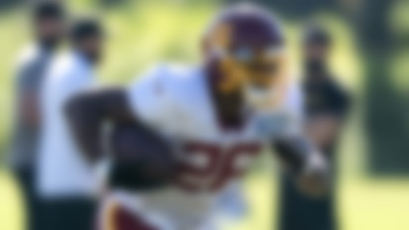 Washington running back Adrian Peterson (26) runs with the ball during practice at the team's NFL football training facility, Tuesday, Aug. 18, 2020, in Ashburn, Va. (AP Photo/Alex Brandon)