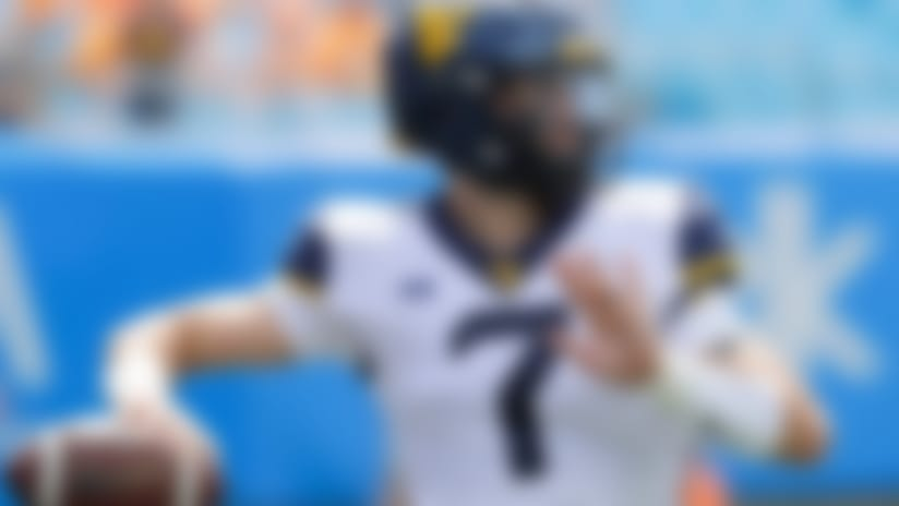 West Virginia's Will Grier (7) warms up before an NCAA college football game against Tennessee in Charlotte, N.C., Saturday, Sept. 1, 2018. (AP Photo/Chuck Burton)