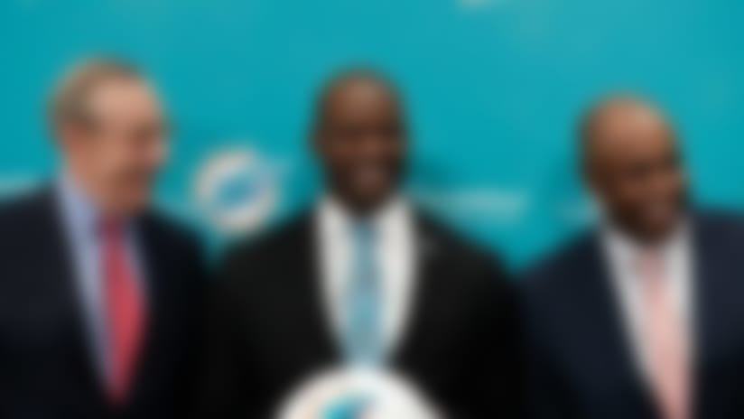 Miami Dolphin's owner Stephen Ross, left, new Miami Dolphin's head coach Brian Flores, center, and general manager Chris Grier, right, pose for a portrait before a news conference on Monday, Feb. 4, 2019, in Davie, Fla. Hours after his team won the Super Bowl, New England Patriots linebackers coach Flores has been hired as head coach of the Miami Dolphins. They decided on Jan. 11. (AP Photo/Brynn Anderson)