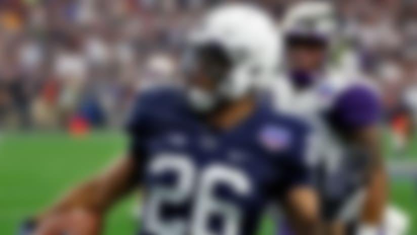 Penn State running back Saquon Barkley (26) breaks free for a 92-yard touchdown run against Washington during the first half of the Fiesta Bowl NCAA college football game, Saturday, Dec. 30, 2017, in Glendale, Ariz. (AP Photo/Rick Scuteri)