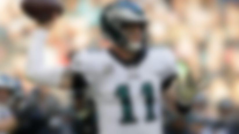 Philadelphia Eagles quarterback Carson Wentz (11) passes the ball during the second half of an NFL football game against Jacksonville Jaguars at Wembley stadium in London, Sunday, Oct. 28, 2018. (AP Photo/Matt Dunham)