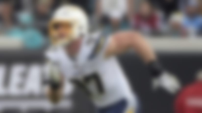 Los Angeles Chargers defensive end Joey Bosa covers a play against the Jacksonville Jaguars during the first half of an NFL football game, Sunday, Dec. 8, 2019, in Jacksonville, Fla. (AP Photo/Phelan M. Ebenhack)