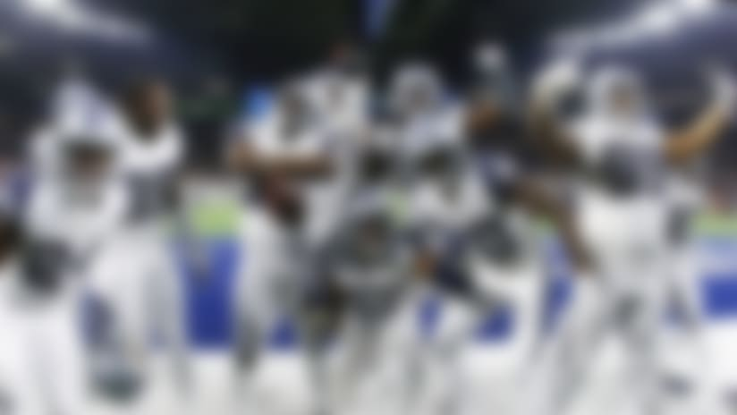 Dallas Cowboys players celebrate their win over -New Orleans Saints in an NFL football game, in Arlington, Texas, Thursday, Nov. 29, 2018. Dallas won 13-10. (AP Photo/Ron Jenkins)