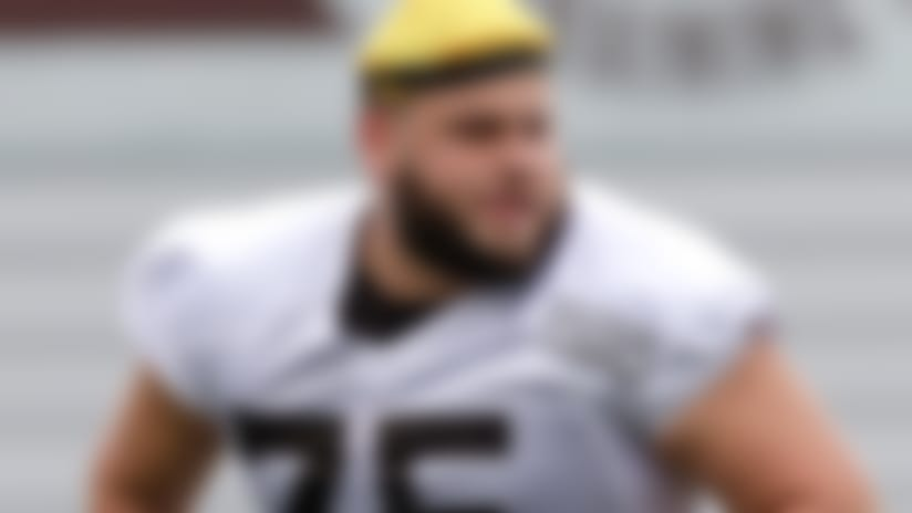 FILE - In this July 27, 2018, file photo,Cleveland Browns offensive tackle Joel Bitonio runs a route during NFL football training camp, in Berea, Ohio. Bitonio would rather not be the one to try and fill Joe Thomas' legendary shoes. One of the NFL's top left guards, Bitonio is content staying at that position unless the Browns need him to slide over and replace Thomas, the 10-time Pro Bowl tackle who retired after last season, leaving a massive hole in Cleveland's line and locker room. (AP Photo/Tony Dejak, File)