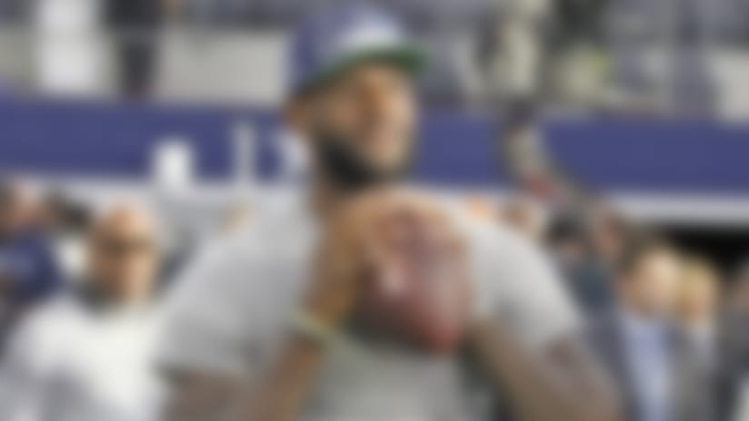 Dallas Cowboys fan and Miami Heat forward LeBron James plays catch before an NFL football game against the New York Giants on Sunday, September 8, 2013, at AT&T Stadium in Arlington, Texas.  The Cowboys defeated the Giants, 36-31.  (AP Photo/James D. Smith)