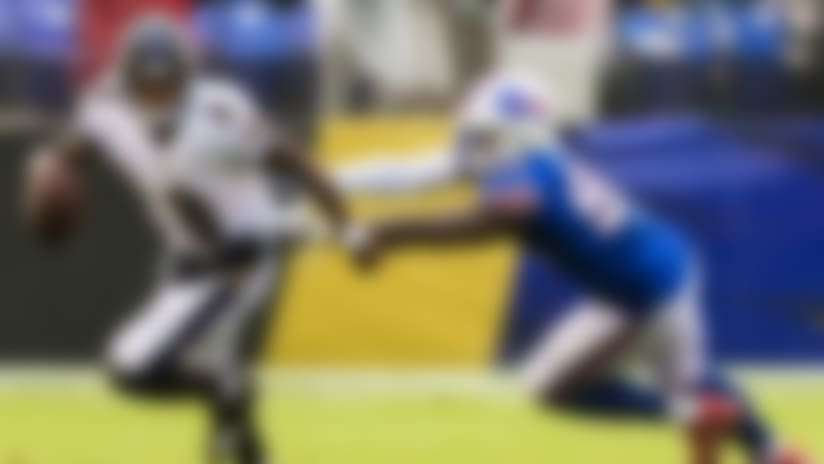 Baltimore Ravens quarterback Lamar Jackson (8) avoids Buffalo Bills defensive end Shaq Lawson (90) during an NFL regular season football game on Sunday, Sept. 9, 2018 in Baltimore. The Ravens won, 47-3. (Ric Tapia via AP)