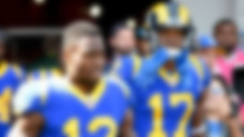 Los Angeles Rams wide receiver Brandin Cooks (12) and wide receiver Robert Woods (17) walk onto the field before an NFL football game against the Green Bay Packers Sunday, Oct. 28, 2018, in Los Angeles. (AP Photo/Denis Poroy)