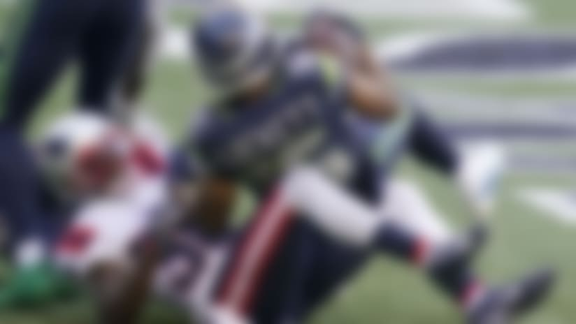 Seattle Seahawks wide receiver Tyler Lockett comes down on top of New England Patriots cornerback Jason McCourty after catching a pass for a touchdown during the first half of an NFL football game, Sunday, Sept. 20, 2020, in Seattle. (AP Photo/Elaine Thompson)