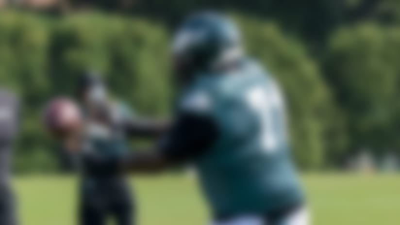 Philadelphia Eagles tackle Jason Peters catches the ball from executive Connor Barwin during an NFL football practice, Thursday, Aug. 27, 2020, in Philadelphia. (AP Photo/Chris Szagola, Pool)