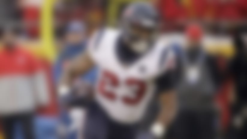 Houston Texans running back Carlos Hyde (23) carries the ball during the first half of an NFL divisional playoff football game against the Kansas City Chiefs, in Kansas City, Mo., Sunday, Jan. 12, 2020. (AP Photo/Charlie Riedel)