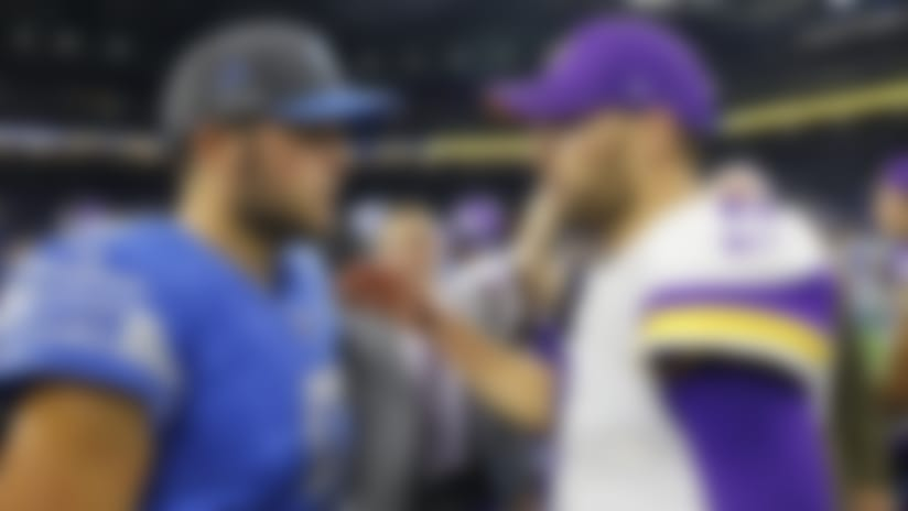 Detroit Lions quarterback Matthew Stafford, left, meets with Minnesota Vikings quarterback Kirk Cousins after an NFL football game, Sunday, Oct. 20, 2019, in Detroit. Minnesota won 42-30. (AP Photo/Rick Osentoski)