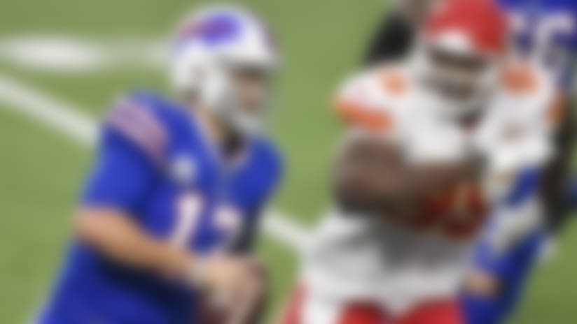 Buffalo Bills quarterback Josh Allen, left, is pressured by Kansas City Chiefs defensive tackle Chris Jones during the first half of an NFL football game, Monday, Oct. 19, 2020, in Orchard Park, N.Y. (AP Photo/Adrian Kraus)