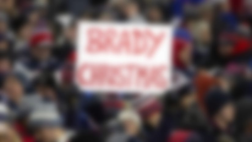 A New England Patriots fan holds a sign outlining her Christmas list during an NFL football game against the Buffalo Bills , Saturday December 21, 2019 in Foxborough, Mass. The Patriots defeated the Bills 24-17. (Damian Strohmeyer via AP)