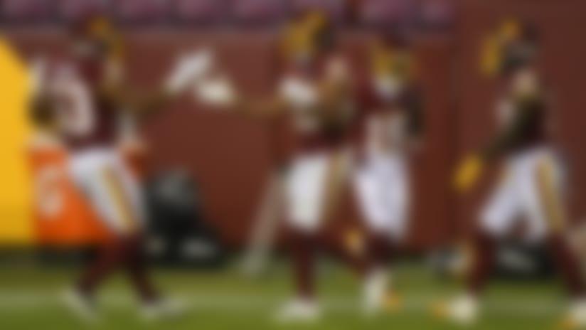 Washington Football Team cornerback Kendall Fuller (29) celebrates a blocked pass with Washington Football Team linebacker Jon Bostic (53) during an NFL football game against the Carolina Panthers, Sunday, Dec. 27, 2020, in Landover, Md. The Panthers defeated Washington 20-13. (Amanda Bowen via AP)