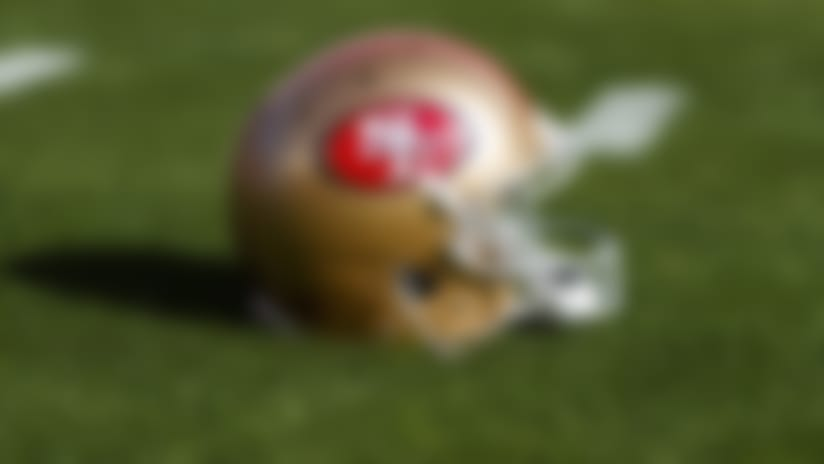 A detail view of a San Francisco 49ers helmet on the grass during warmups prior to an NFL divisional playoff football game against the Minnesota Vikings, Saturday, Jan. 11, 2020, in Santa Clara, Calif. The 49ers defeated the Vikings, 27-10. (Ryan Kang via AP)