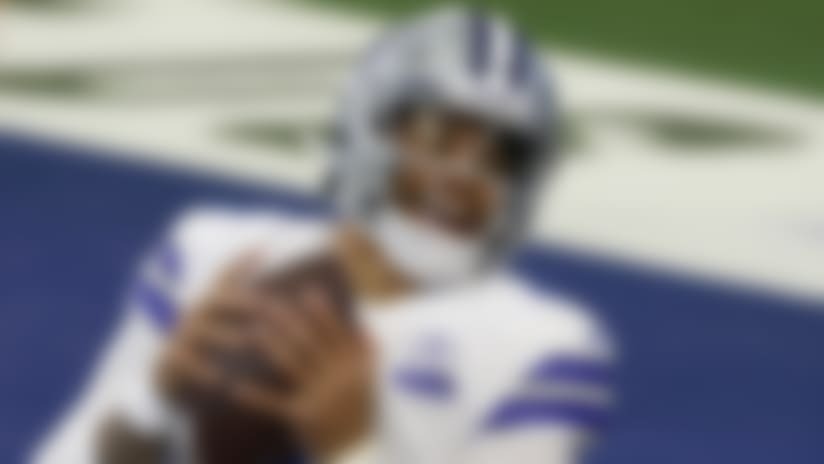 Dallas Cowboys quarterback Dak Prescott makes a catch for a touchdown in the first half of an NFL football game against the New York Giants in Arlington, Texas, Sunday, Oct. 11, 2020. (AP Photo/Ron Jenkins)