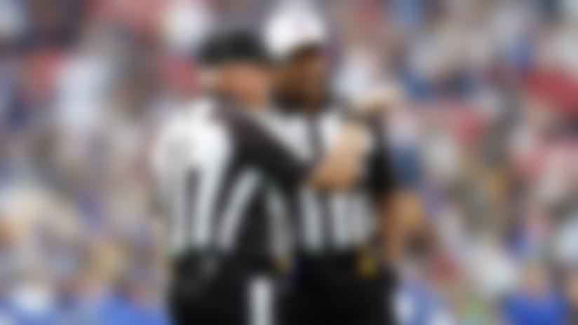NFL referee Jerome Boger (23) talks with line judge Rusty Baynes (59) during an NFL football game between the Los Angeles Rams and the Arizona Cardinals, Sunday, Dec. 29, 2019, in Los Angeles. The Rams defeated the Cardinals, 31-24. (Ryan Kang via AP)