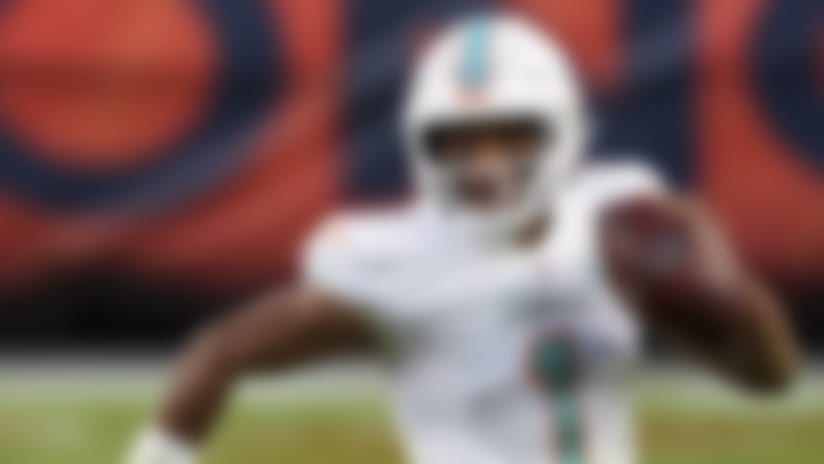 Miami Dolphins quarterback Tua Tagovailoa (1) looks to pass while running with the football against the Denver Broncos during the second half of an an NFL football game, Sunday, Nov.. 22, 2020, in Denver. (AP Photo/Justin Edmonds)