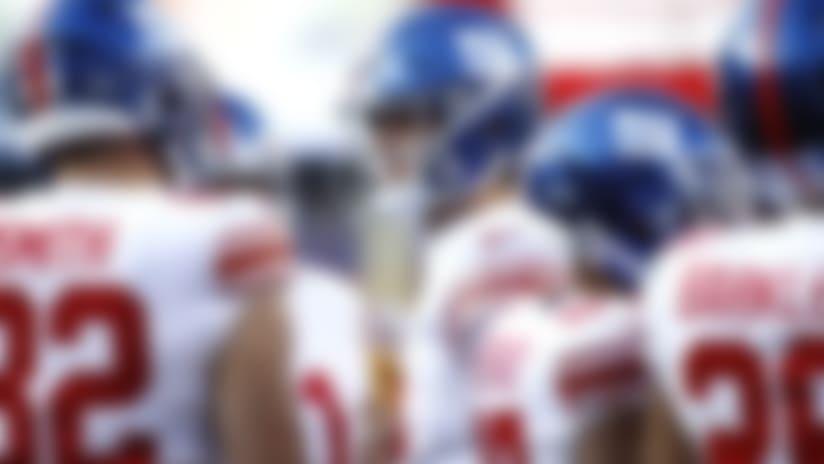 New York Giants quarterback Daniel Jones, center, talks to teammates during the first half of an NFL football game against the Washington Redskins, Sunday, Dec. 22, 2019, in Landover, Md. (AP Photo/Patrick Semansky)