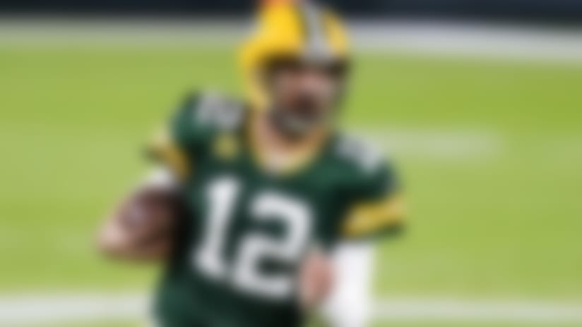 Green Bay Packers' Aaron Rodgers runs during the first half of an NFL football game against the Chicago Bears Sunday, Nov. 29, 2020, in Green Bay, Wis. (AP Photo/Matt Ludtke)