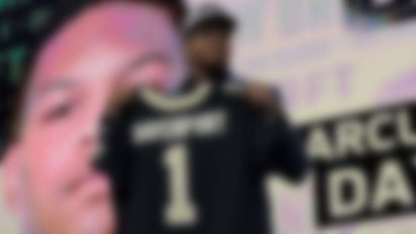 UTSA's Marcus Davenport poses with his New Orleans Saints jersey after being selected by the team during the first round of the NFL football draft, Thursday, April 26, 2018, in Arlington, Texas. (AP Photo/David J. Phillip)