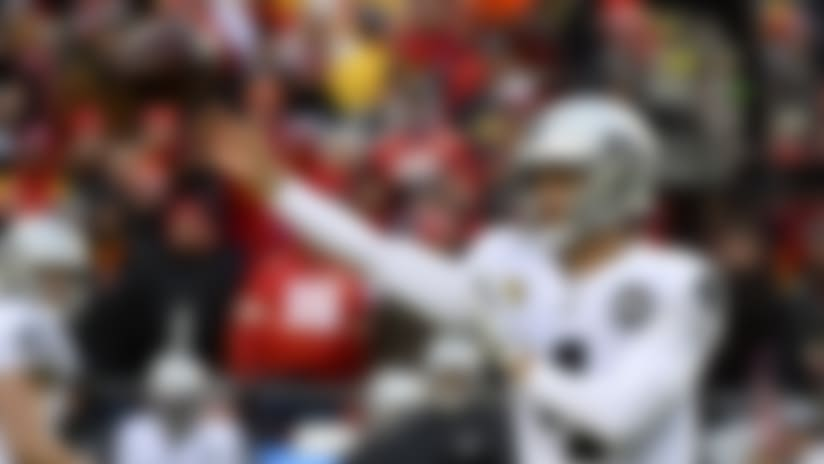 Oakland Raiders quarterback Derek Carr (4) throws a pass during the first half of an NFL football game against the Kansas City Chiefs in Kansas City, Mo., Sunday, Dec. 1, 2019. (AP Photo/Ed Zurga)