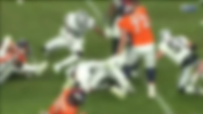 Clelin Ferrell recovers after Royce Freeman fumbles the handoff
