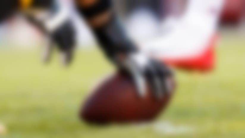 A detail shot of a player about to snap the football.