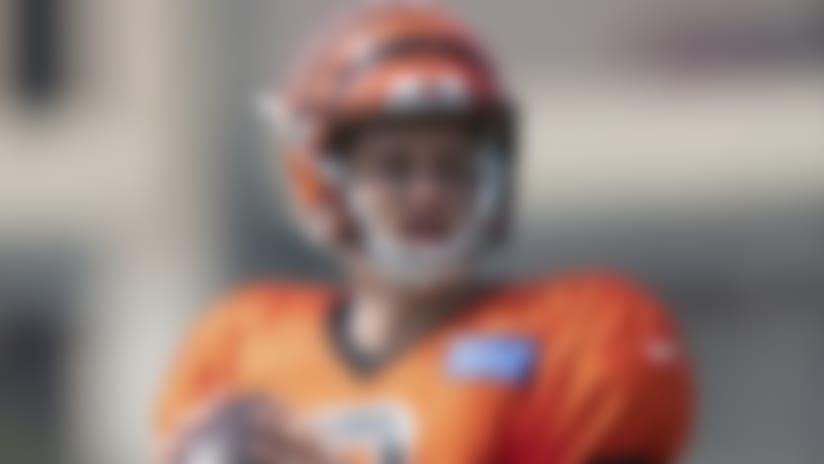 Cincinnati Bengals' Joe Burrow (9) looks to pass during an NFL football camp practice in Cincinnati, Monday, Aug. 24, 2020. (Ryan Meyer via AP)
