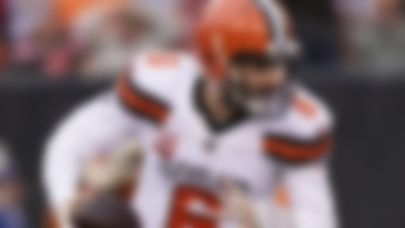 In this Dec. 29, 2019, photo, Cleveland Browns quarterback Baker Mayfield scrambles during the first half of an NFL football game against the Cincinnati Bengals in Cincinnati. The most compelling dramas in the NFL this season unfolded on the field, not off of it. And any thought that the league was in jeopardy of losing its spot as America's favorite sport has been set on the back burner. (AP Photo/Bryan Woolston)