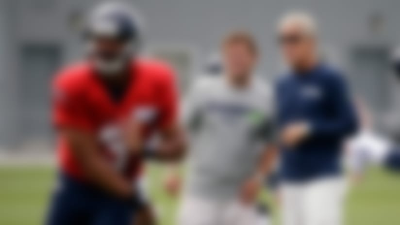 Schneider's obsession with Russell Wilson as a prospect paid off for the GM and Seahawks coach Pete Carroll (right).