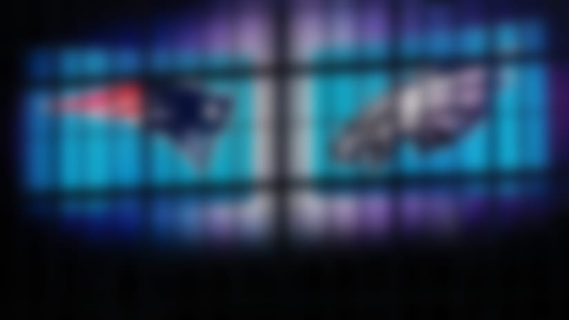 A detail view of the Patriots and Eagles logos.