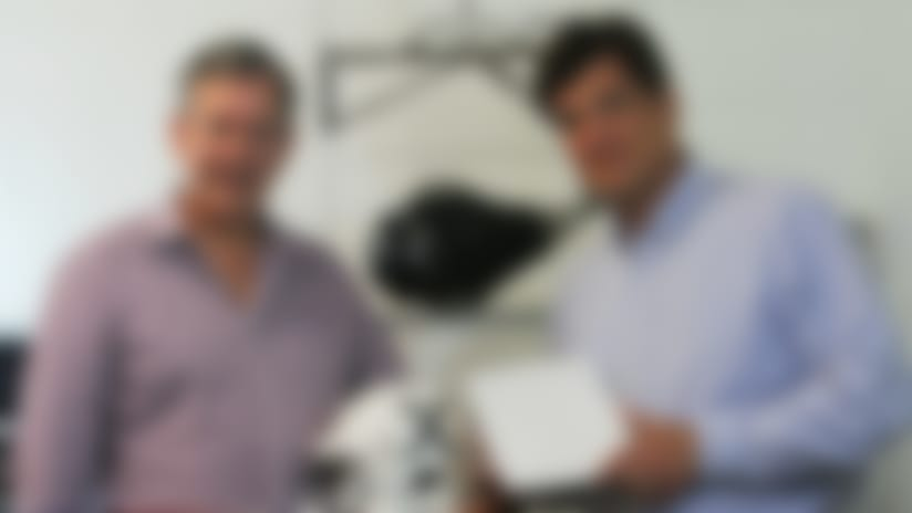 """Corsair Innovations' Sander Reynolds (left) and William Lyndon (right) display a prototype football helmet and their unique helmet liner, """"Fiber Energy Absorbing Material,"""" or FEAM. Photo courtesy of Corsair Innovations."""