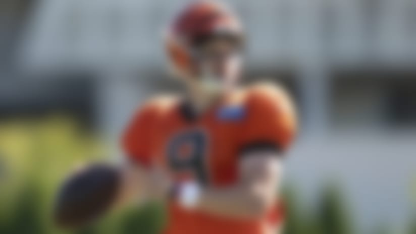 Cincinnati Bengals' Joe Burrow (9) throws a pass during an NFL football camp practice in Cincinnati, Thursday, Aug. 20, 2020. (Ryan Meyer via AP)