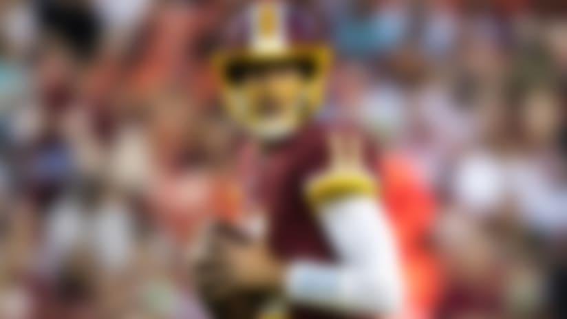 Washington Redskins quarterback Alex Smith (11) looks to pass during the NFL Game against the Denver Broncos, Friday Aug. 24, 2018, Landover, MD. The Broncos defeated the Redskins 29-17. (Al Tielemans via AP)
