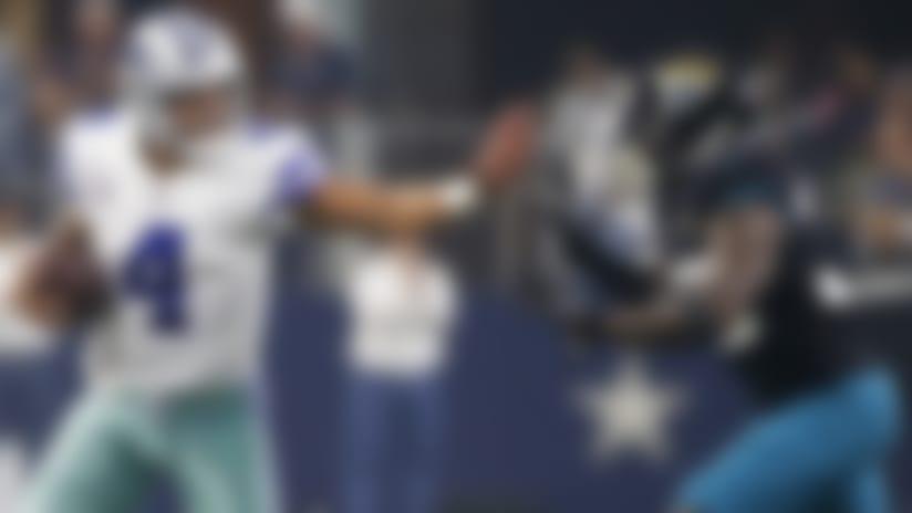 Dallas Cowboys quarterback Dak Prescott (4) looks for room against Jacksonville Jaguars safety Tashaun Gipson (39) in the first half of an NFL football game in Arlington, Texas, Sunday, Oct. 14, 2018. (AP Photo/Ron Jenkins)