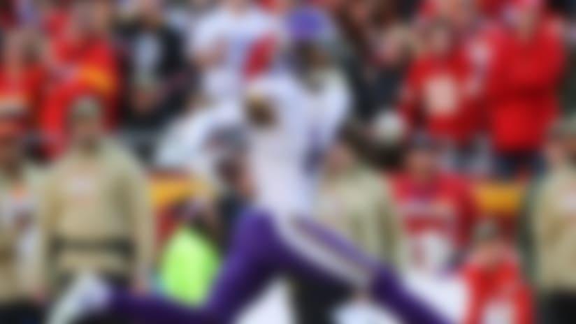 Minnesota Vikings wide receiver Stefon Diggs (14) runs against the Kansas City Chiefs during the second half at Arrowhead Stadium.