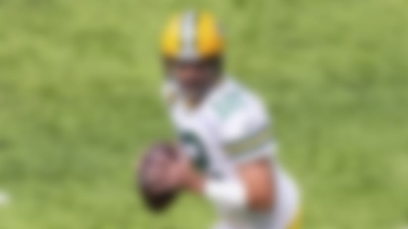 Green Bay Packers quarterback Aaron Rodgers (12) runs with the ball in the second quarter during an NFL football game against the Minnesota Vikings, Sunday, Sept. 13, 2020, in Minneapolis. (AP Photo/David Berding)