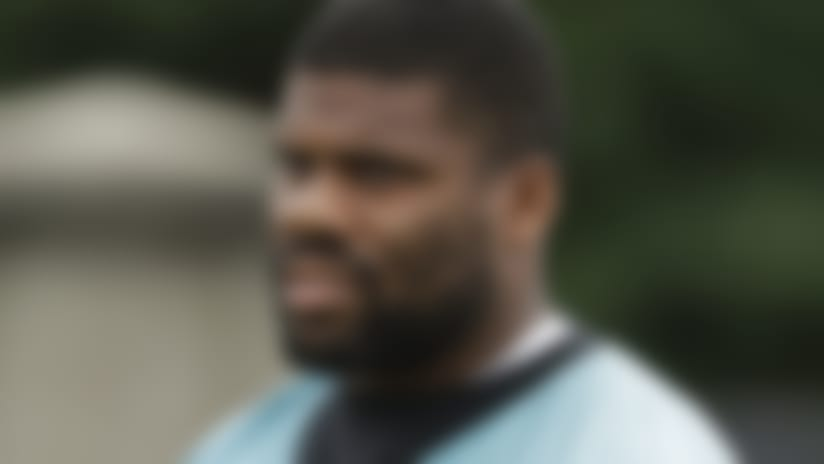 Carolina Panthers' Daryl Williams (60) arrives before the NFL football team's practice in Charlotte, N.C., Tuesday, June 12, 2018. (AP Photo/Chuck Burton)
