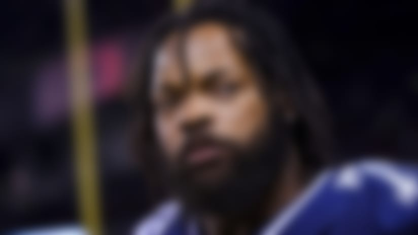 Dallas Cowboys defensive end Michael Bennett (79) takes the field prior to an NFL football game against the Chicago Bears, Sunday, Dec. 8, 2019, in Chicago. The Bears won 31-24. (Aaron Doster via AP)