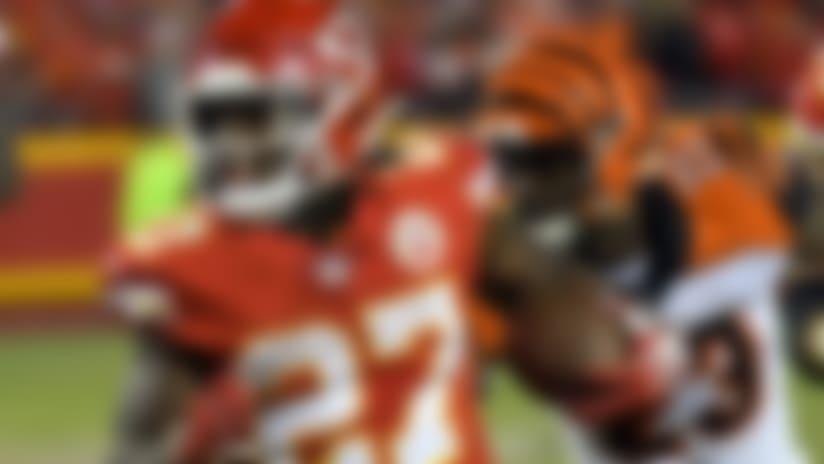 Kansas City Chiefs running back Kareem Hunt (27) runs away from Cincinnati Bengals cornerback Darius Phillips (23) during the second half of an NFL football game in Kansas City, Mo., Sunday, Oct. 21, 2018. (AP Photo/Reed Hoffmann)