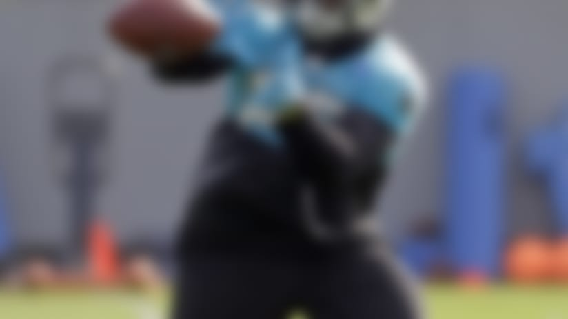 Carolina Panthers' C.J. Anderson catches a pass during practice at the NFL football team's facility in Charlotte, N.C., Tuesday, May 22, 2018. While NFL owners are voting to approve the new Panthers owner in Atlanta, the team David Tepper is about to officially own takes to the field for the OTAs back in Charlotte with plenty of new faces. (AP Photo/Chuck Burton)