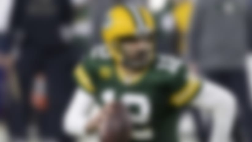Green Bay Packers quarterback Aaron Rodgers (12) in action during an NFL divisional playoff football game between the Los Angeles Rams and Green Bay Packers, Saturday, Jan. 16, 2021, in Green Bay, Wis. (AP Photo/Jeffrey Phelps)