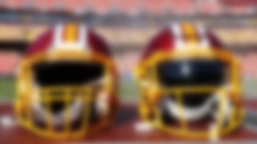 Washington Redskins helmets sit on a equipment trunk with mist in the background in a inside general stadium view before an NFL preseason football game against the Baltimore Ravens, Thursday, Aug. 29, 2019, in Landover, MD. The Ravens beat the Redskins 20-7. (Matt Patterson via AP)