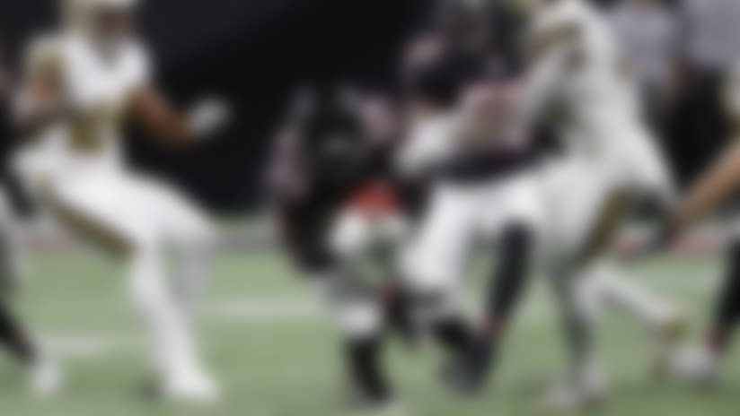 Atlanta Falcons linebacker Foye Oluokun (54) picks up an onside kick against the New Orleans Saints during the second half of an NFL football game, Thursday, Nov. 28, 2019, in Atlanta. (AP Photo/John Bazemore)