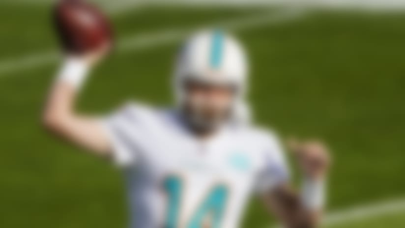 Miami Dolphins quarterback Ryan Fitzpatrick (14) warms up against the Denver Broncos during an NFL football game Sunday, Nov. 22, 2020, in Denver. (AP Photo/Jack Dempsey)